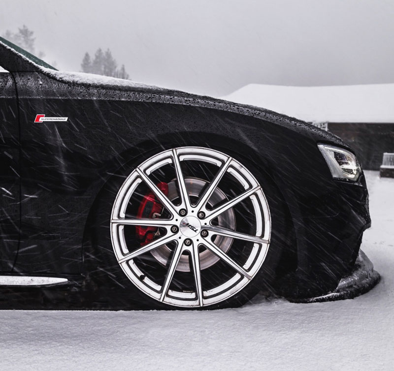 Black Audi S5 coupe in the snow